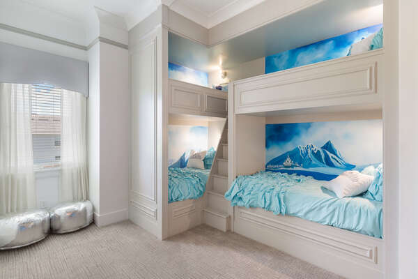 This bedroom features three custom twin/twin bunk beds