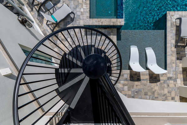 The spiral staircase will lead you towards the pool area from the second floor