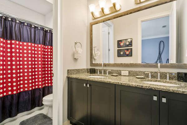 The en-suite bathroom has dual vanity and combination of shower/tub