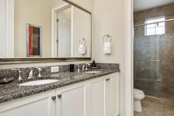En-suite bathroom 5 features a dual vanity and walk-in shower