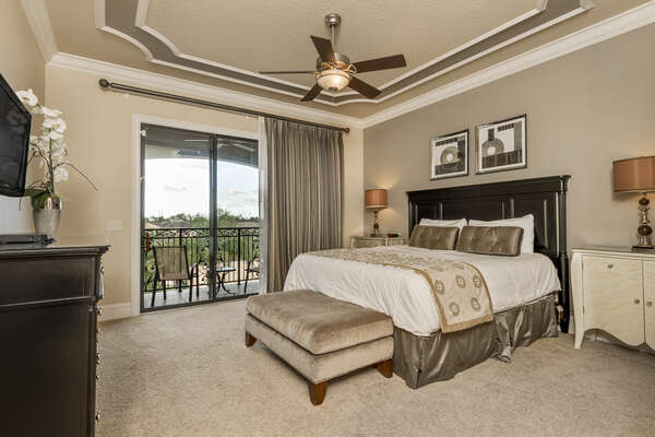 Master suite 4 features a king bed, en-suite bathroom, 32-inch TV, and access to patio balcony
