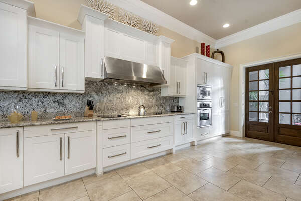 The fully equipped gourmet kitchen to prepare meals with stainless steel appliances