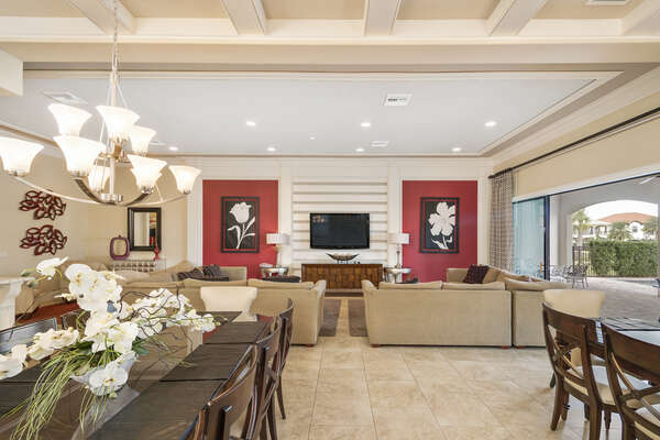 The spacious living area features a 65-inch TV and Blu-Ray player