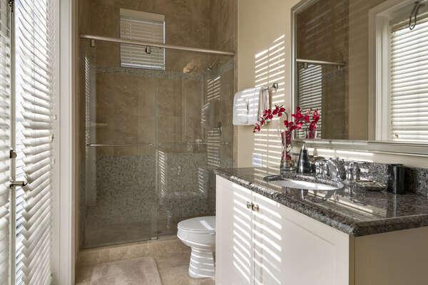 The en-suite bathroom has a glass walk-in shower