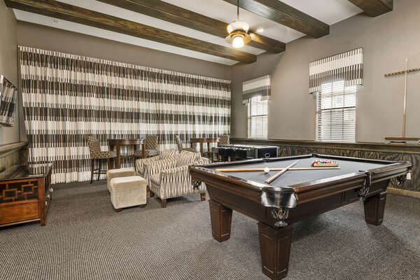 The games room features a pool table, foosball table, 42-inch TV, and DVD player