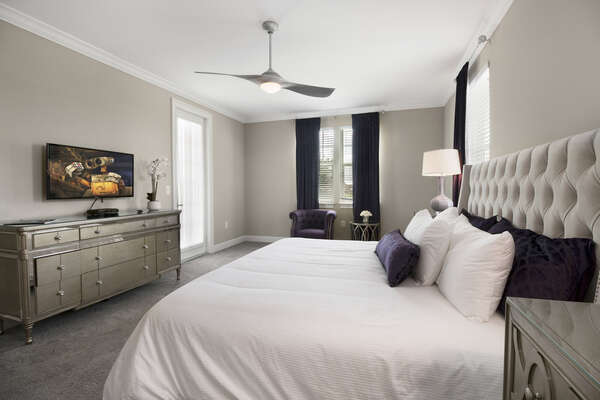 Overhead fan and a SMART TV makes this a great bedroom to sneak away to.