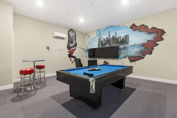The air conditioned games room features a pool table, 50-inch SMART TVs, and PlayStation 4
