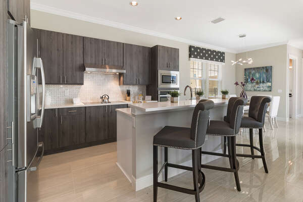 Spacious fully-equipped kitchen with a breakfast bar