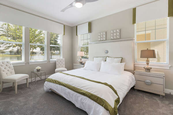 The first master suite on the ground floor features a king size bed