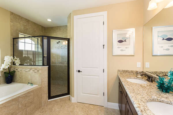 Master suite bathroom with large walk in shower, garden tub, and dual vanity