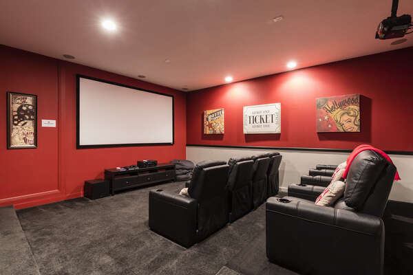 Enjoy the theater room with a 120-Inch projection screen, Apple TV 2, DVD player, and PS4