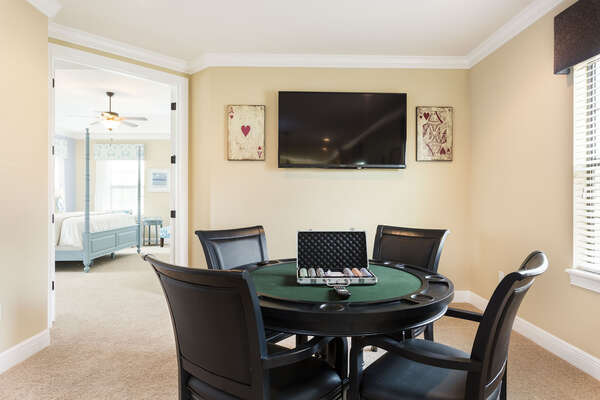 The loft also has a poker table and wall mounted TV