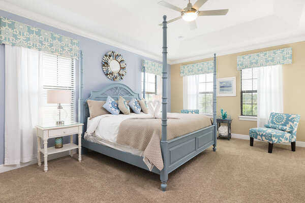 With a pop blue, this master bedroom on the second floor features a king bed and en-suite bathroom