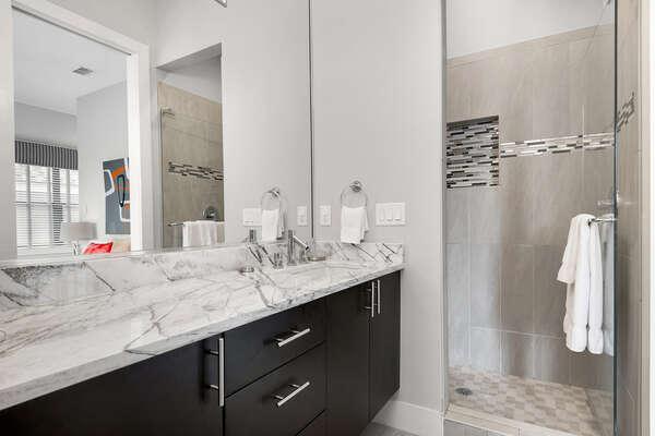 En-suite bathroom 2 has marble vanity and glass door walk-in shower
