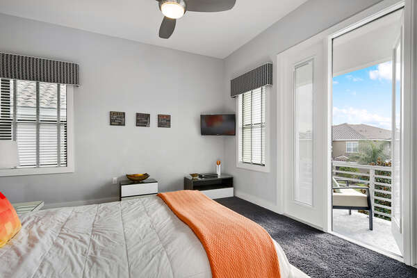 The bedroom also features a 32-inch TV and access to a private balcony