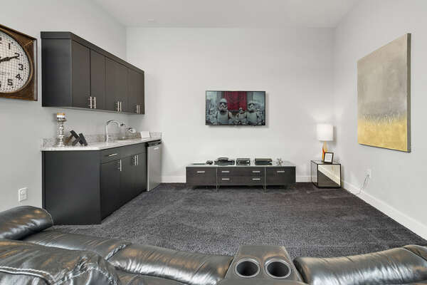 The games room features a 50-inch TV, PlayStation 3, Wet bar, and 60-in-1 multi-arcade machine