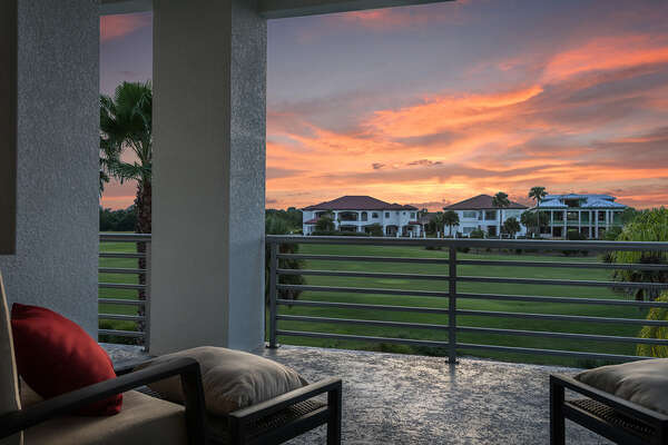 Take in the scenic views of the golf course from the private patio balcony