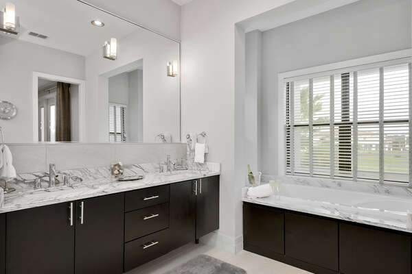 The master en-suite bathroom features marble dual vanity and garden tub for relaxation