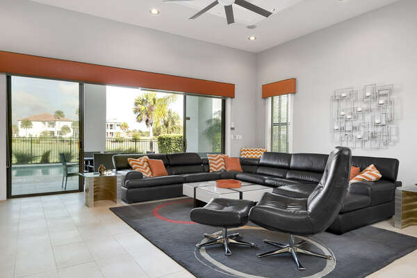 Enjoy the modern style living area with breathtaking views of the pool area