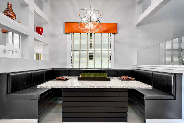 The booth-style dining area allows you to enjoy your meals with family comfortably