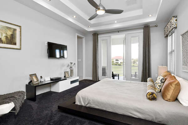 The master suite features a king bed, 40-inch TV, and access to private patio balcony