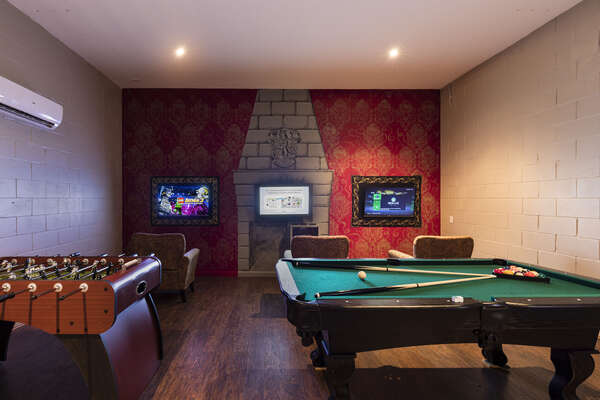 The games room with a pool table, foosball table, and PS4