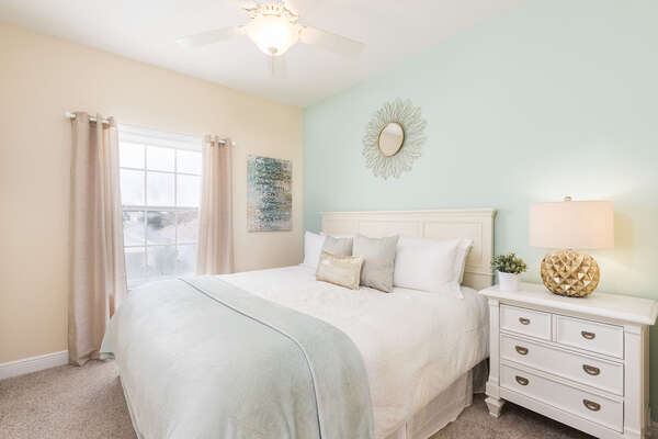 The second bedroom located in the second floor has a king size bed