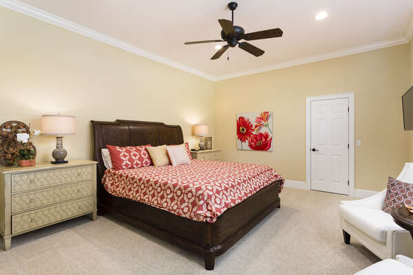 The second master bedroom has a king bed, flatscreen TV and overhead ceiling fan