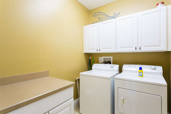 There is a laundry room with washer and dryer