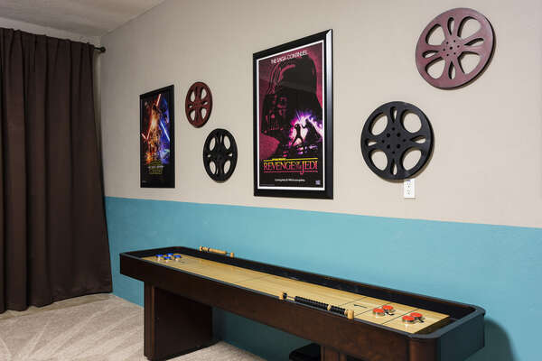 The games room has a shuffleboard table as well