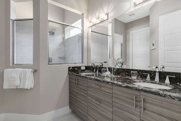 The ensuite bathroom has his and hers vanity and large walk-in shower