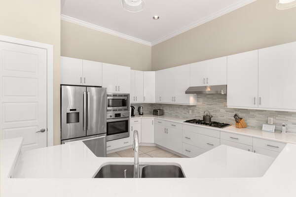 The kitchen has granite counters and stainless steel appliances