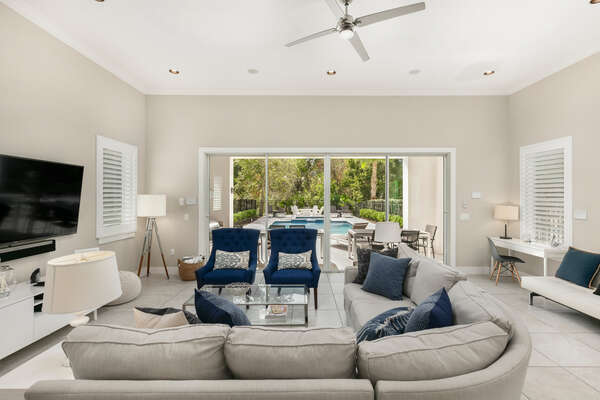 The living area is bright and airy with easy access to the pool deck