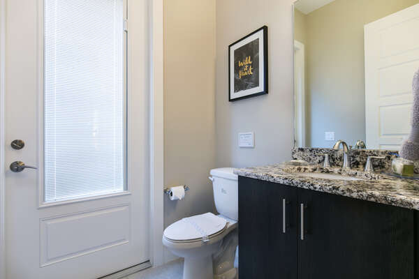 The first floor features a half bathroom