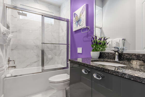 The ensuite bathroom offers more privacy and space