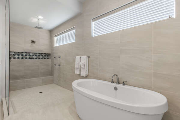 Take a shower under the rainfall showerhead or soak in your large bathtub