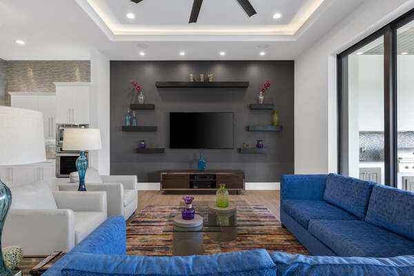 The living area offers a large flatscreen TV