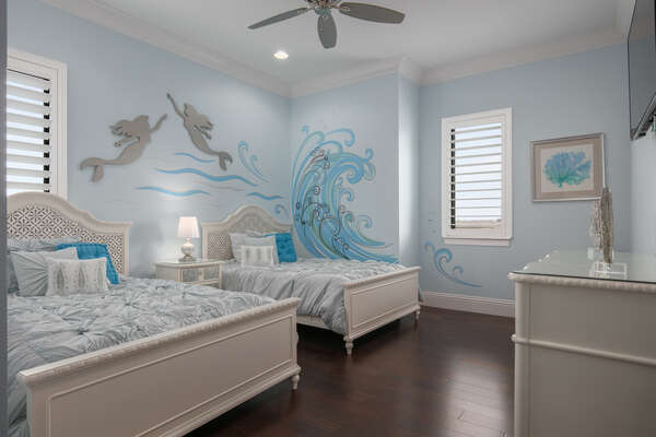 The Mermaids Suite features two full beds and en-suite bathroom