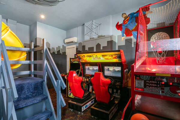 The games room features an air hockey table, 70-Inch TV, and awesome slide
