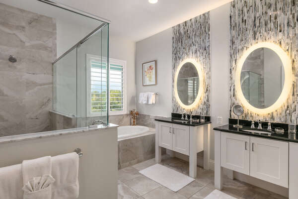Master en-suite bathroom with glass walk-in shower and garden tub