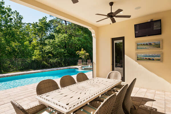 The pool & patio area also includes a plasma TV