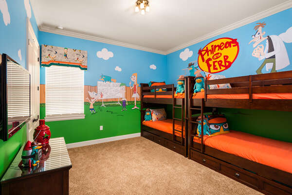 Another fun kids bedroom with twin over twin bunk beds and twin trundles and 50-inch SMART TV