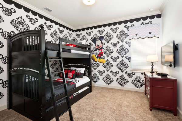Fun kids bedroom with full over full bunk bed and twin trundle and 50-inch SMART TV