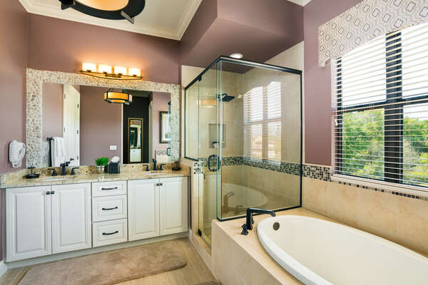 Master suite bathroom 2 includes a rain shower head and touches of stone decor