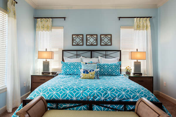 Bright accents of color and soft floral arrangements add flair to upstairs master suite 5 bedroom