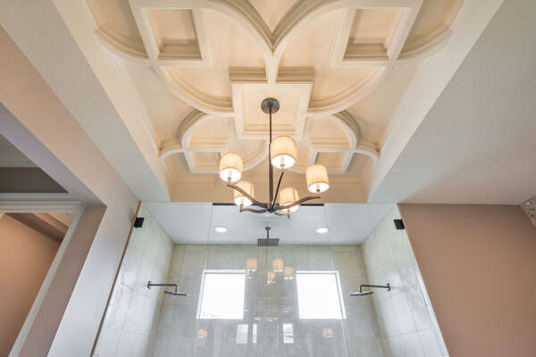 The ornate vaulted ceiling in master suite bathroom 1 adds a hint of Mediterranean elegance