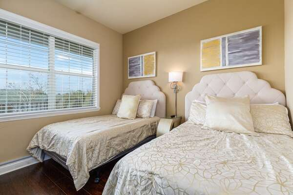 Two full beds in this comfortable bedroom