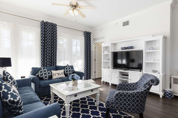 Featuring a large open living space with comfortable seating for everyone and a 55 inch SMART TV