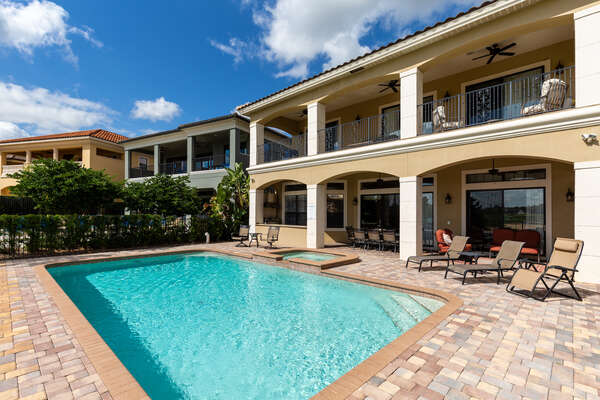 The outdoor pool deck is upgraded with an outdoor TV and comfortable seating