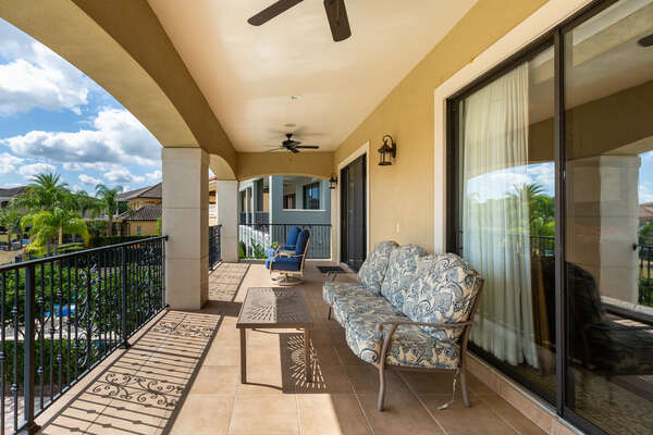 The back patio balcony is the perfect place to sip a beverage and enjoy the amazing views